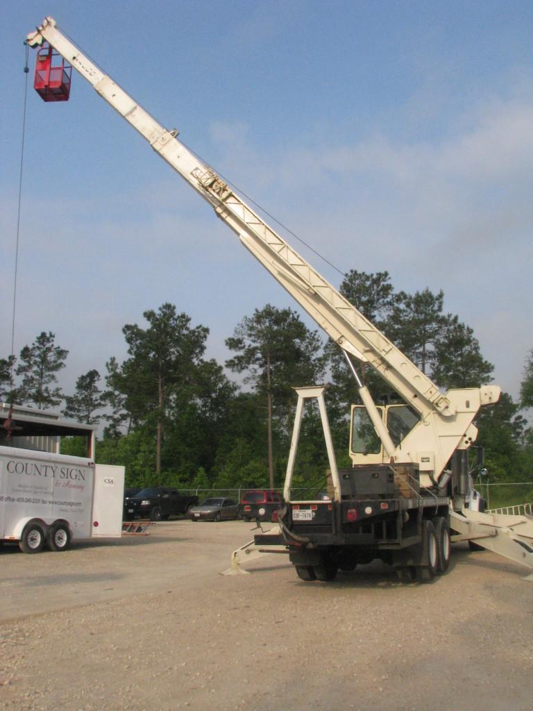 County Sign and awning SETX crane rental, SETX Crane Rental Company, Auger service Beaumont TX, crane rental Port Arthur, crane rental Nederland Tx, crane rental Bridge City TX